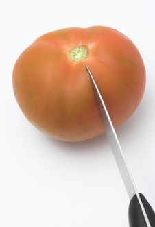 Free Knife Cutting A Tomato Stock Photography - 356522