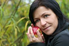 Woman And Apple In Autumn Park Stock Photos