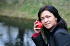 Woman And Apple In Autumn Park Stock Photography