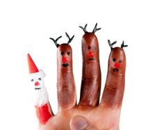 Three Funny Reindeer And Santa  Painted On The Fingers Royalty Free Stock Images