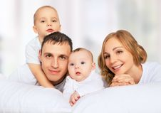 Free Happy Family Of Father, Mother And Children In White Bed Royalty Free Stock Photo - 35062975