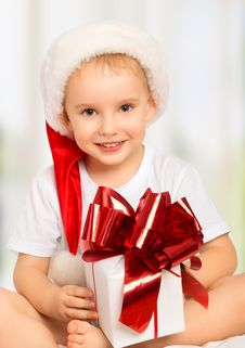 Free Little Cute Child Boy In A Christmas Hat With A Gift Stock Image - 35063081