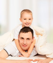 Free Happy Family. Dad And Son Playing In Bed Stock Image - 35063171