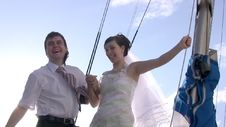 Groom, Bride, Yacht And Sun Royalty Free Stock Photography