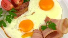 Plate With Fried Eggs. Close-up Stock Photo