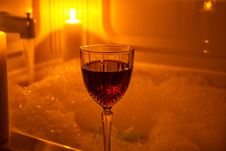 A Glass Of Wine And Bubble Bath Royalty Free Stock Photos