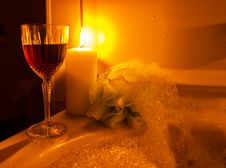 A Glass Of Wine And Bubble Bath Stock Images
