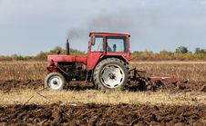 Red Tractor At Work Royalty Free Stock Photography