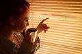 Free Woman With Coffee Stares Through Blinds Early Morning Royalty Free Stock Images - 35096549