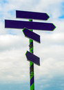 Free Signpost With Arrows Pointing On Sky Stock Photos - 35098343