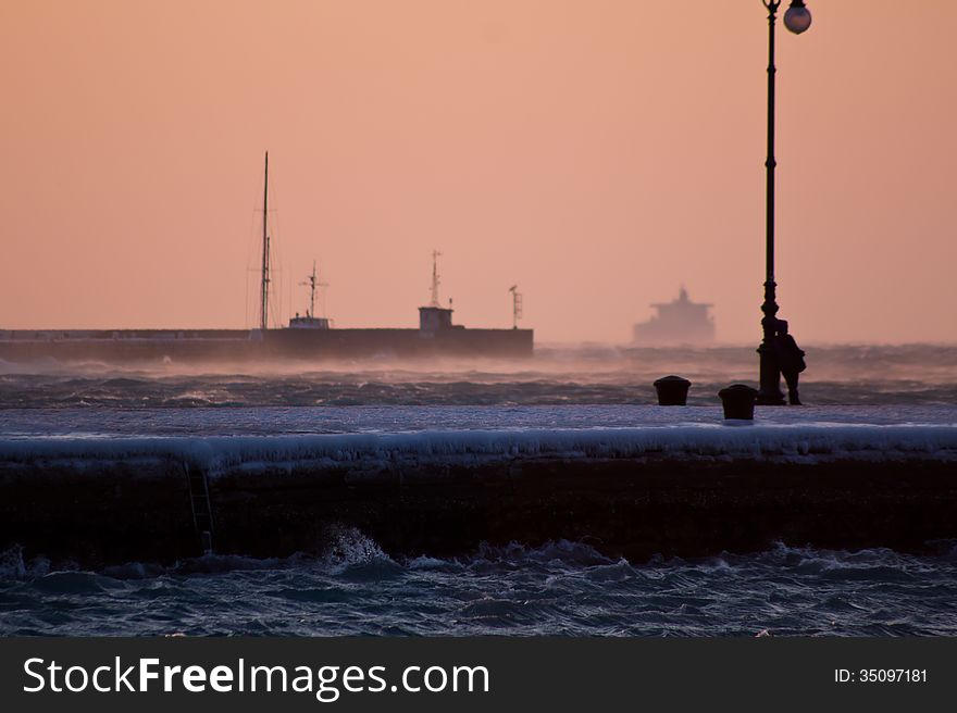 Evening on the frosty pier of Trieste