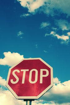 Free Stop Sign And The Clouded Sky Royalty Free Stock Images - 3515409