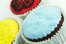 Three Cupcakes On The White Background Stock Photos