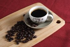 A Cup Of Robusta Coffee At And Coffee Beans Stock Image