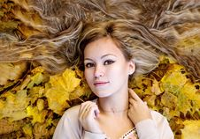 Free Beautiful Woman Lying With Autumn Leaves Stock Photo - 35142020