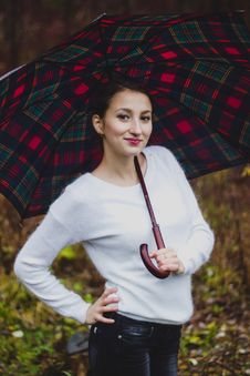 Free Girl In White Sweater Smiling With Umbrella Stock Image - 35142911