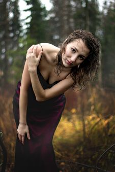 Free Portrait Of Woman In Purple Dress Under Rain Stock Photography - 35143032