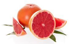 Free The Cut Grapefruit With Leaves Royalty Free Stock Photography - 35145337