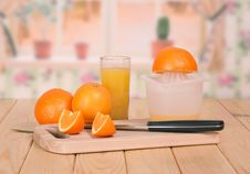 Knife, Segments Of Orange And A Juice Glass Stock Images