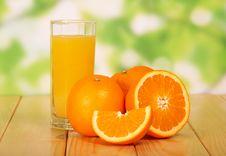 Free Orange Juice On A Wooden Table Stock Photo - 35150200