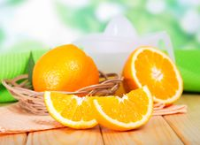 Segments Of Orange And A Juice Extractor Stock Photography