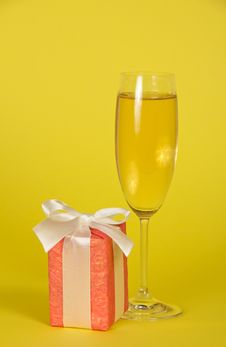Wine Glass, Gift Box With Ribbon And Bow Stock Photo