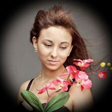 Free Young Caucasian Woman With Orchid Royalty Free Stock Photos - 35158358