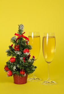 Small Christmas Fir-tree In A Pot, And Two Wine Stock Photo