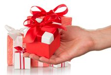 Free Hand Holding A Gift Royalty Free Stock Image - 35172386
