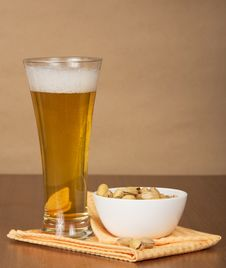Beer, Pistachios And Napkin Royalty Free Stock Photography