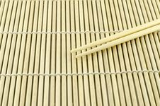 Free Two Chopsticks On Sushi Mat Stock Image - 35179031