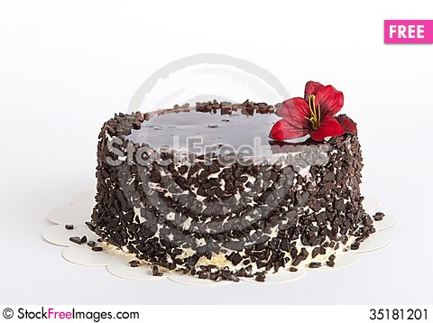 Free Chocolate Cake With Chocolate On Uneven Light Background, Cake Isolated On Warm Light Background With Selective Focus And Uneven L Stock Image - 35181201