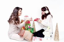 Free Two Smiling Women Opening Christmas Presents Royalty Free Stock Images - 35180899