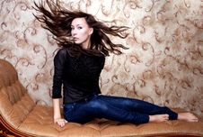 Free Beautiful Girl Waving Her Brown Hair On Vintage Couch Royalty Free Stock Images - 35183889