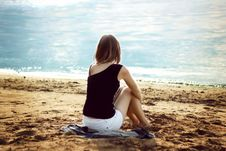 Free Lonely Girl Relaxing On The Sea Beach Royalty Free Stock Images - 35184359