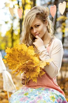 Free Smiling Girl With Colorful Autumn Leaves Royalty Free Stock Photo - 35184705