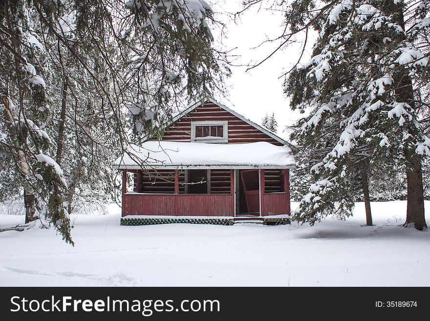 A log cabin in the trees