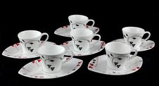6 Cups On A Black Background Royalty Free Stock Photos
