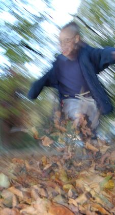 Free Boy Kicking Leaves Stock Photography - 3522262