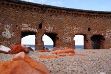 Brick Building On The Sand Stock Images