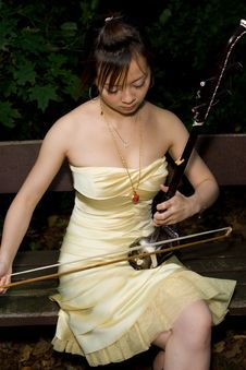 Young Girl Playing Erhu Royalty Free Stock Images