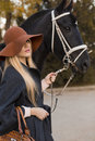 Free Beautiful Girl With Black Horse Royalty Free Stock Photos - 35206538