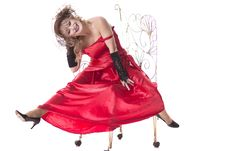 Free Woman In A Red Dress Posing On A Chair Royalty Free Stock Photography - 35200577