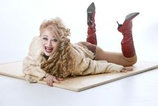 Free Curly-haired Woman In A Fur Coat Lying On The Parquet Royalty Free Stock Image - 35200596
