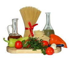 Pasta, Tomatoes, Pepper,greens And Olive Oil On A Cutting Board Stock Image