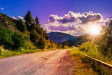 Free Mountain Road Near The Coniferous Forest With Cloudy Morning Sky Stock Photos - 35209033