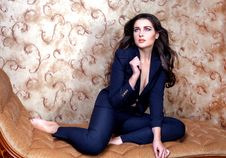 Free Sexy Woman In Suit On Vintage Couch Royalty Free Stock Photography - 35224367