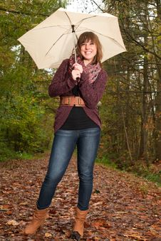 Free Girl And Her Umbrella Royalty Free Stock Photo - 35225375