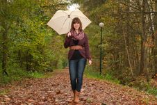 Free Walking With An Umbrella Stock Photos - 35225393