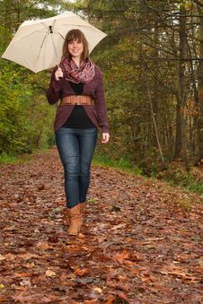 Free Walking In The Park With An Umbrella Stock Photography - 35225402